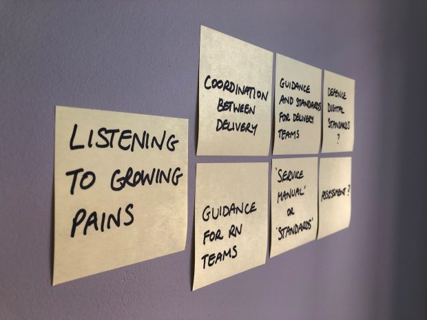 Seven post it notes stuck to a wall outlining the considerations NELSON took when developing the standards