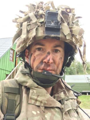 An image of Chris Sykes in military uniform