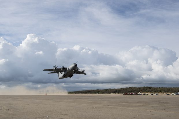 Pictured is an RAF A400M Atlas transport aircraft carrying out a series of spectacular test landings and take offs on a beach in South Wales.