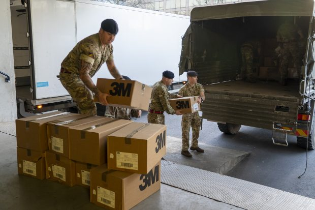 Soldiers from 4 Regiment, Royal Logistic Corps loading boxes into the back of a lorry