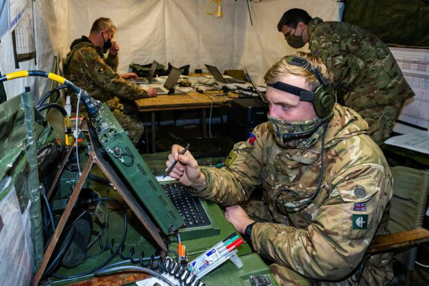 A Lance Corporal is seen here using the server to download incoming emails inside the main improvised command post which is behind a 4 tonne truck.